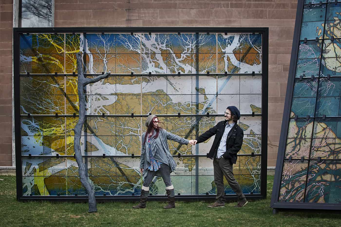 Urban Photo Locations - young hipster couple walking past an enormous wall mural