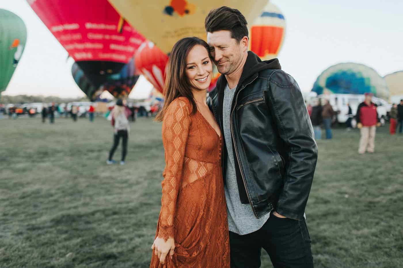 Memorable Photo Locations - Free People styled couple in love at a hot air balloon festival