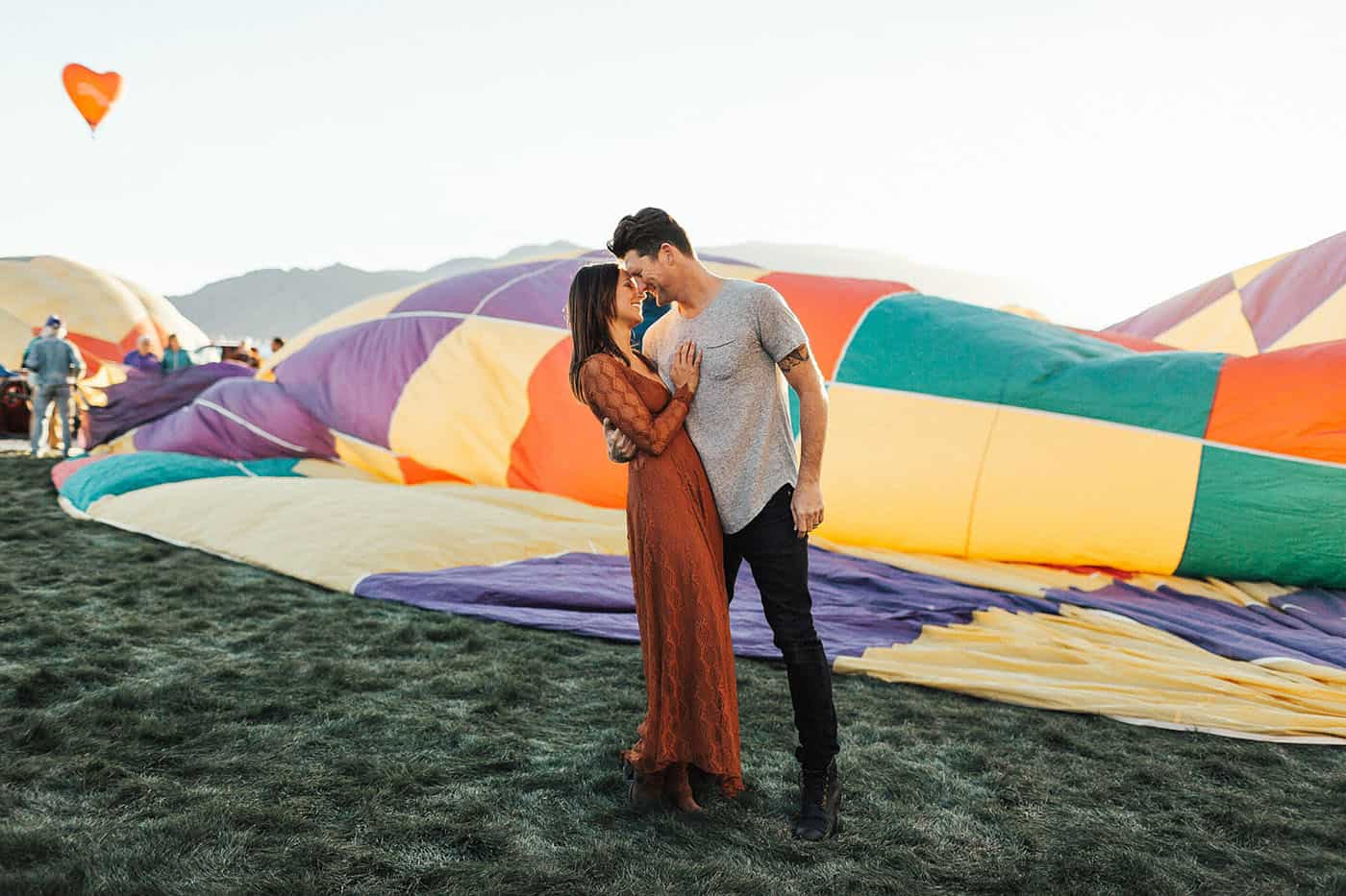 Memorable Photo Locations - brunette couple gazing into one another's eyes at a hot air balloon festival