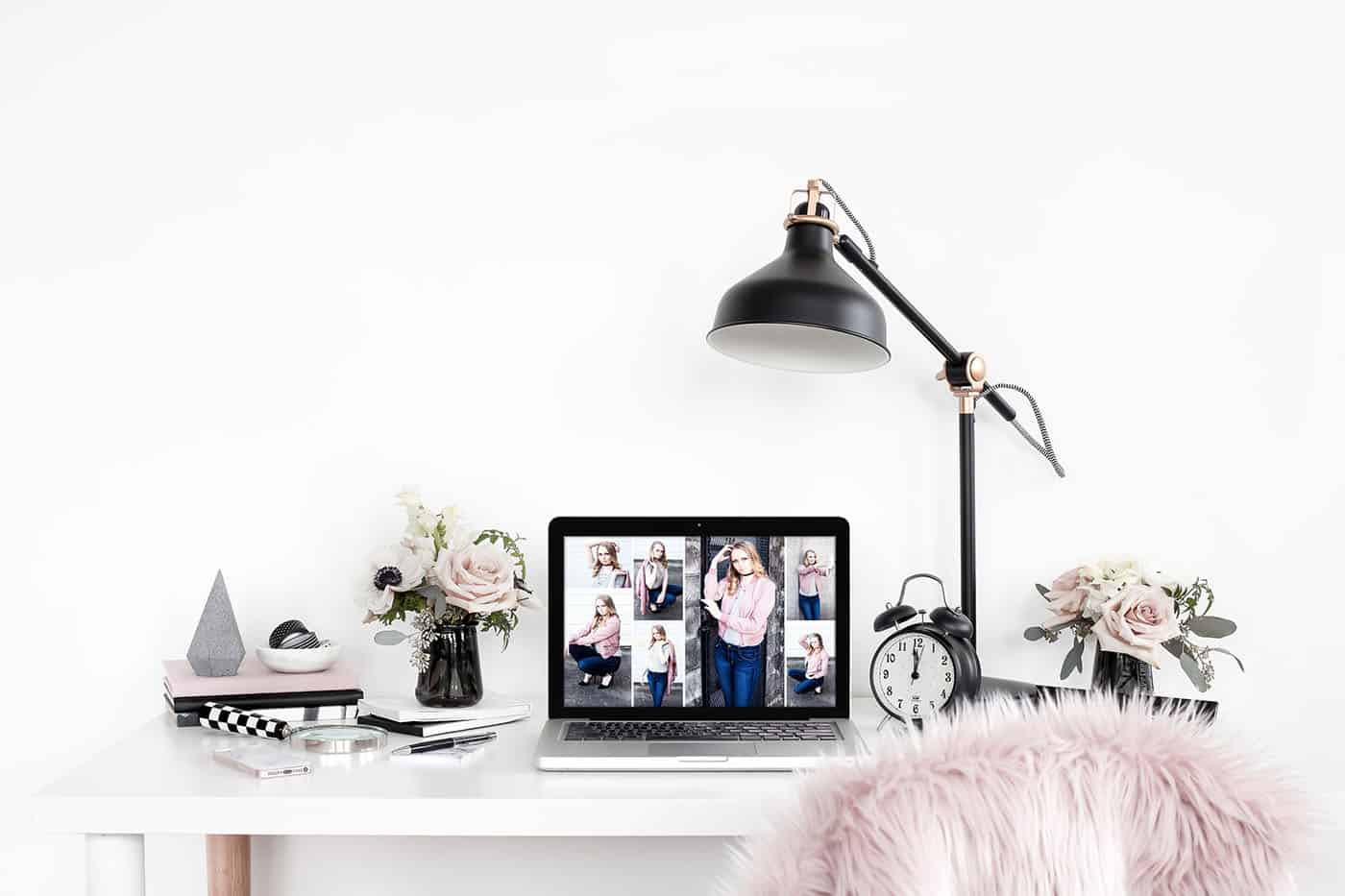 white desktop with pink and black accessories
