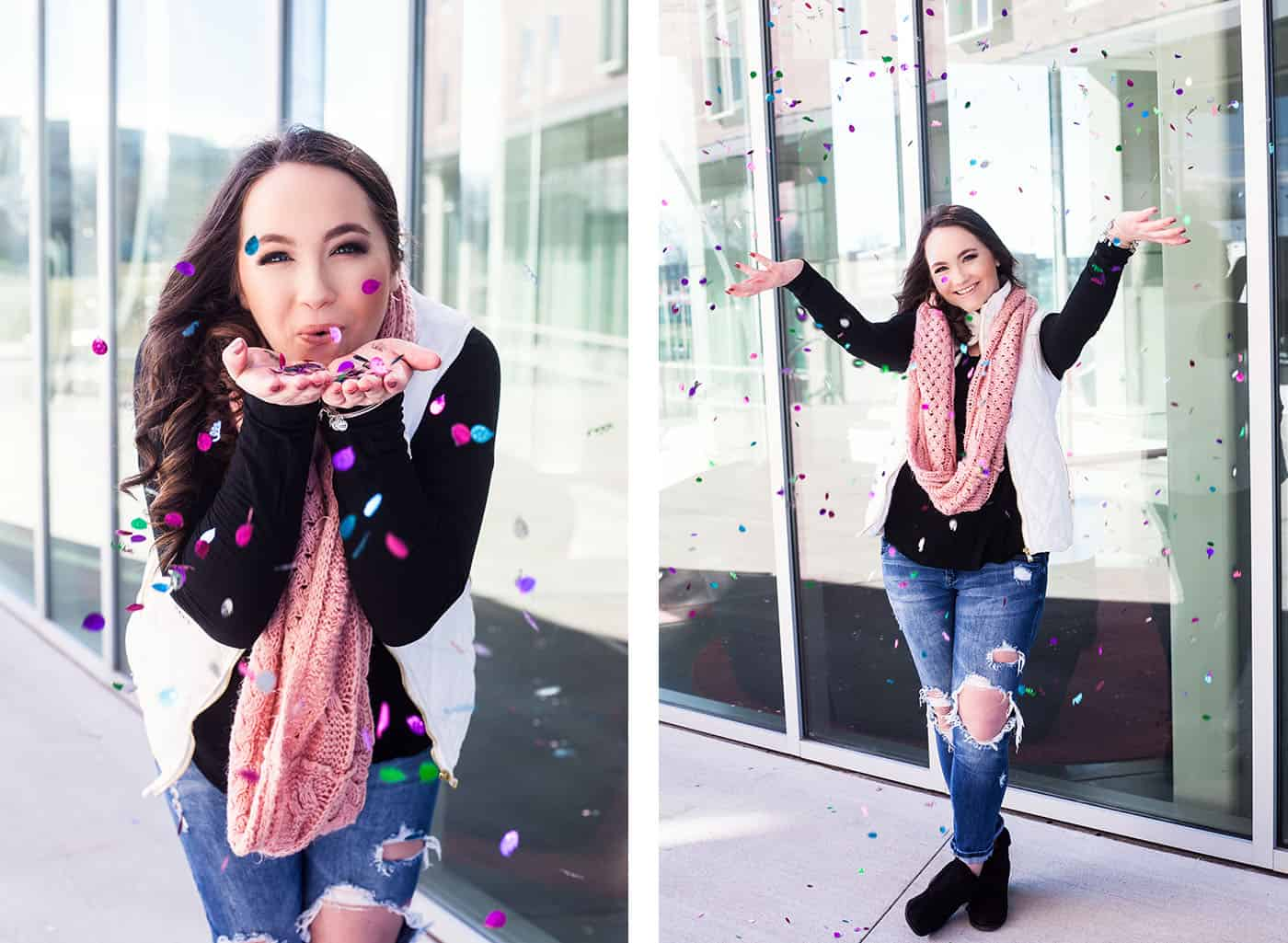senior girl tossing confetti by reflective glass