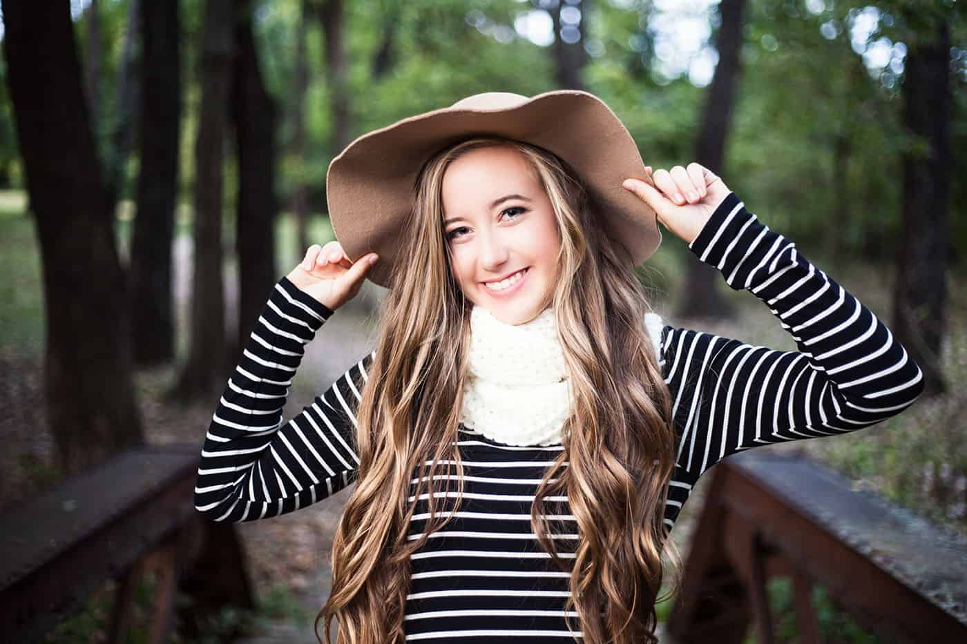 beautiful blonde smiling teenage girl in a floppy hat by Heather Yeager