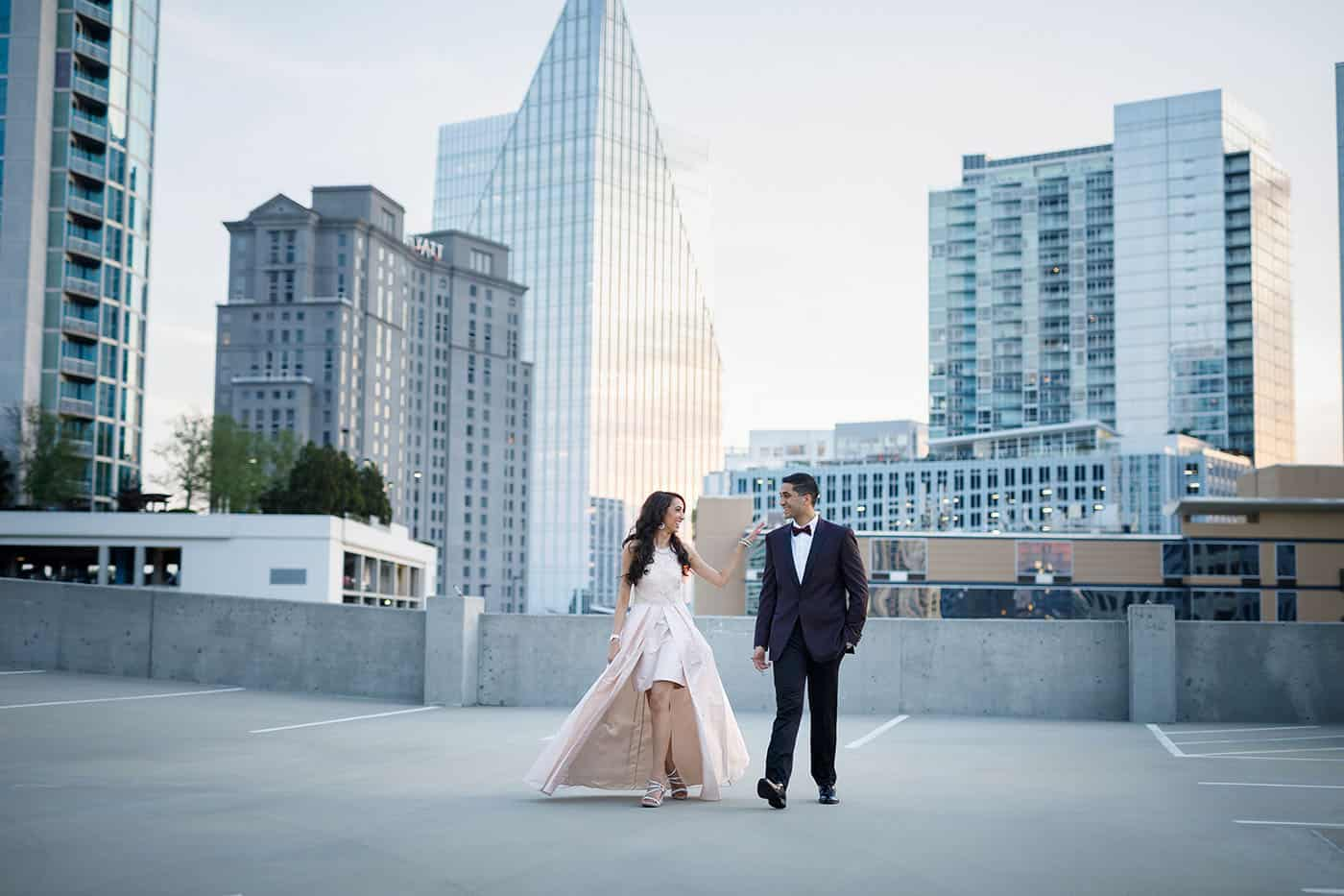 This is the Key to Amazing Client Relationships | A bride and groom stroll across the rooftop parking garage in the heart of downtown Atlanta.