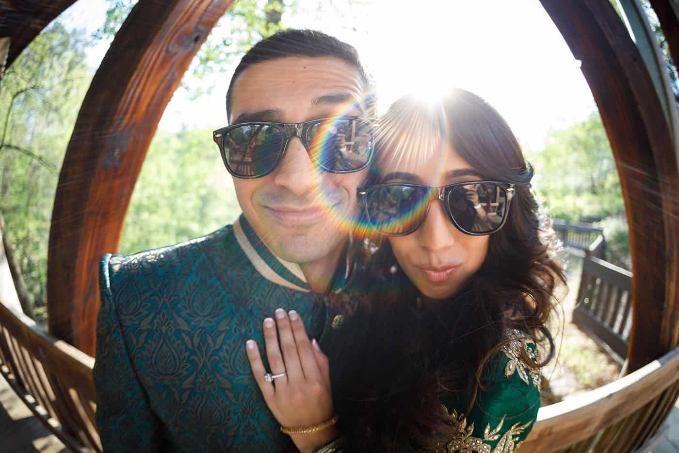 This is the Key to Amazing Client Relationships | An Indian couple pose for a fisheye portrait in their sunglasses.