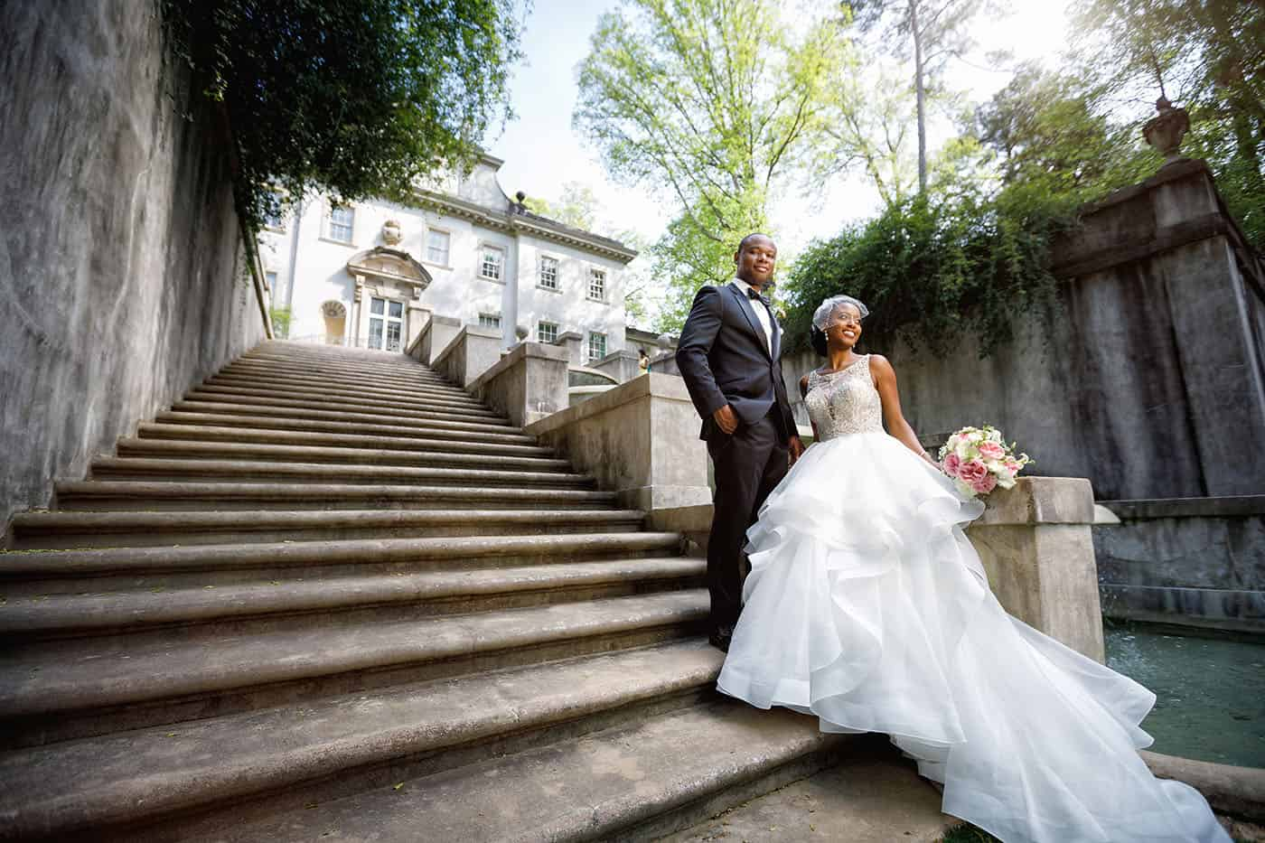This is the Key to Amazing Client Relationships | A bride and groom pose on the broad stone staircase that leads up to the Atlanta History Center's Swan Mansion.