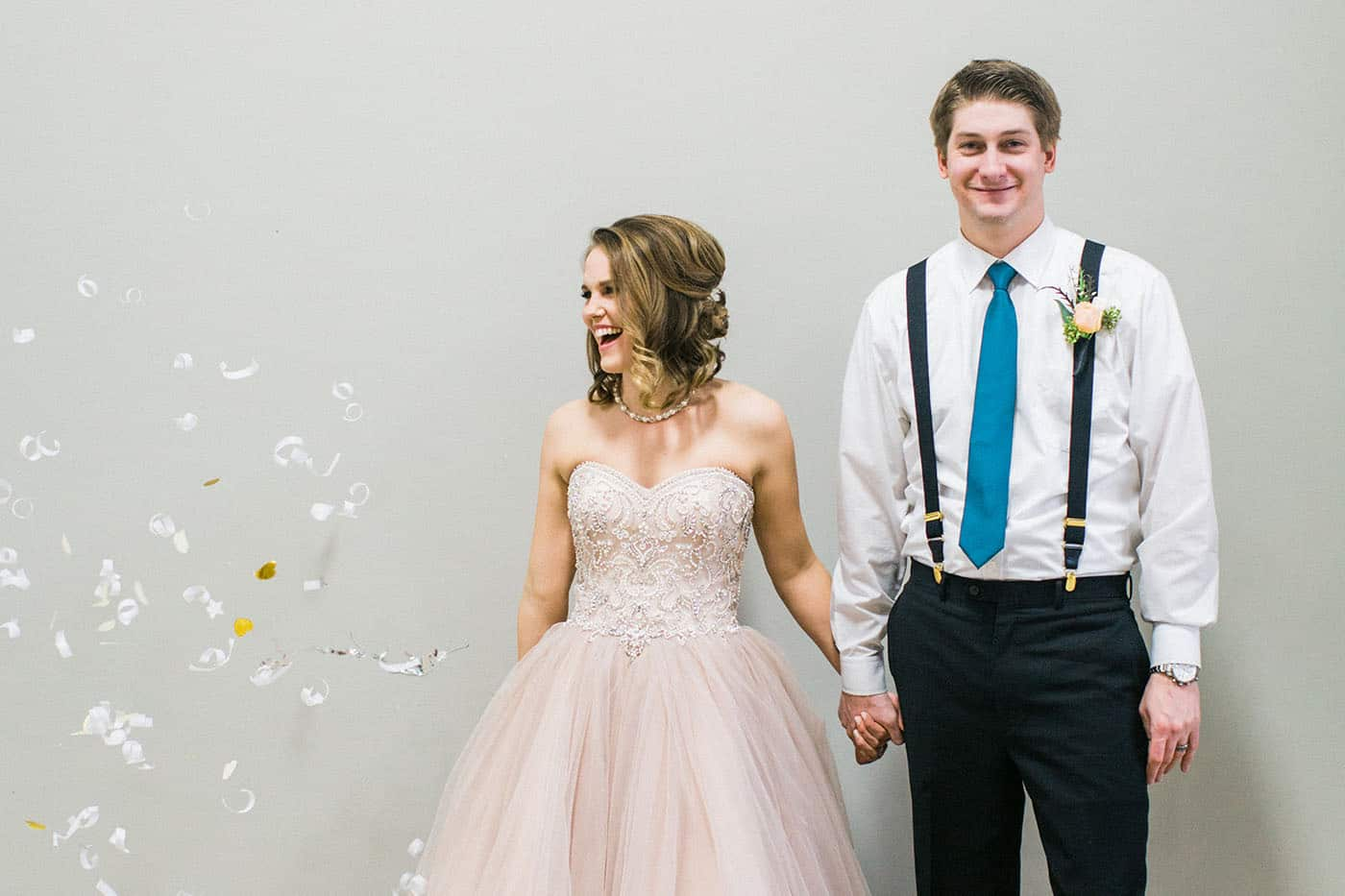 laughing bride and groom under confetti rachael osborn client questions