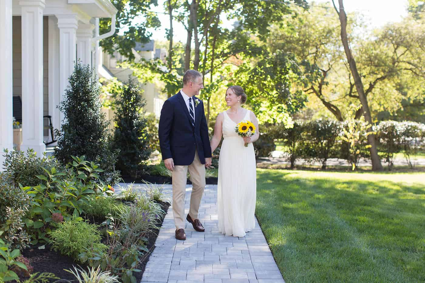 bride with sunflower bouquet walking down the aisle by customer service whiz cinnamon wolfe