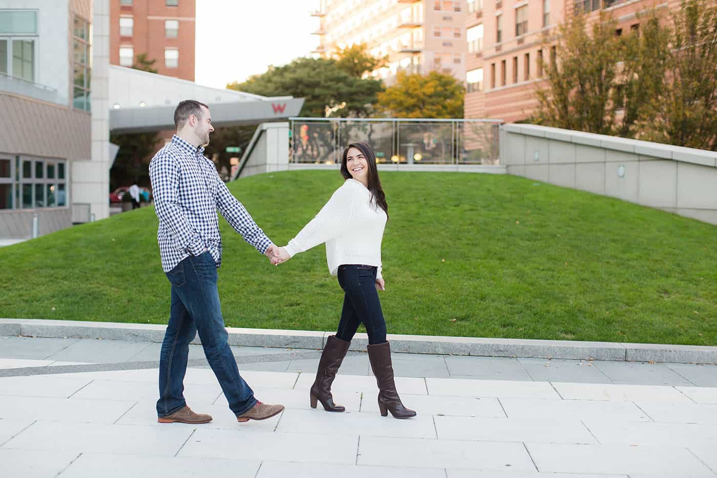 happy engaged couple walking through the city by customer service whiz cinnamon wolfe