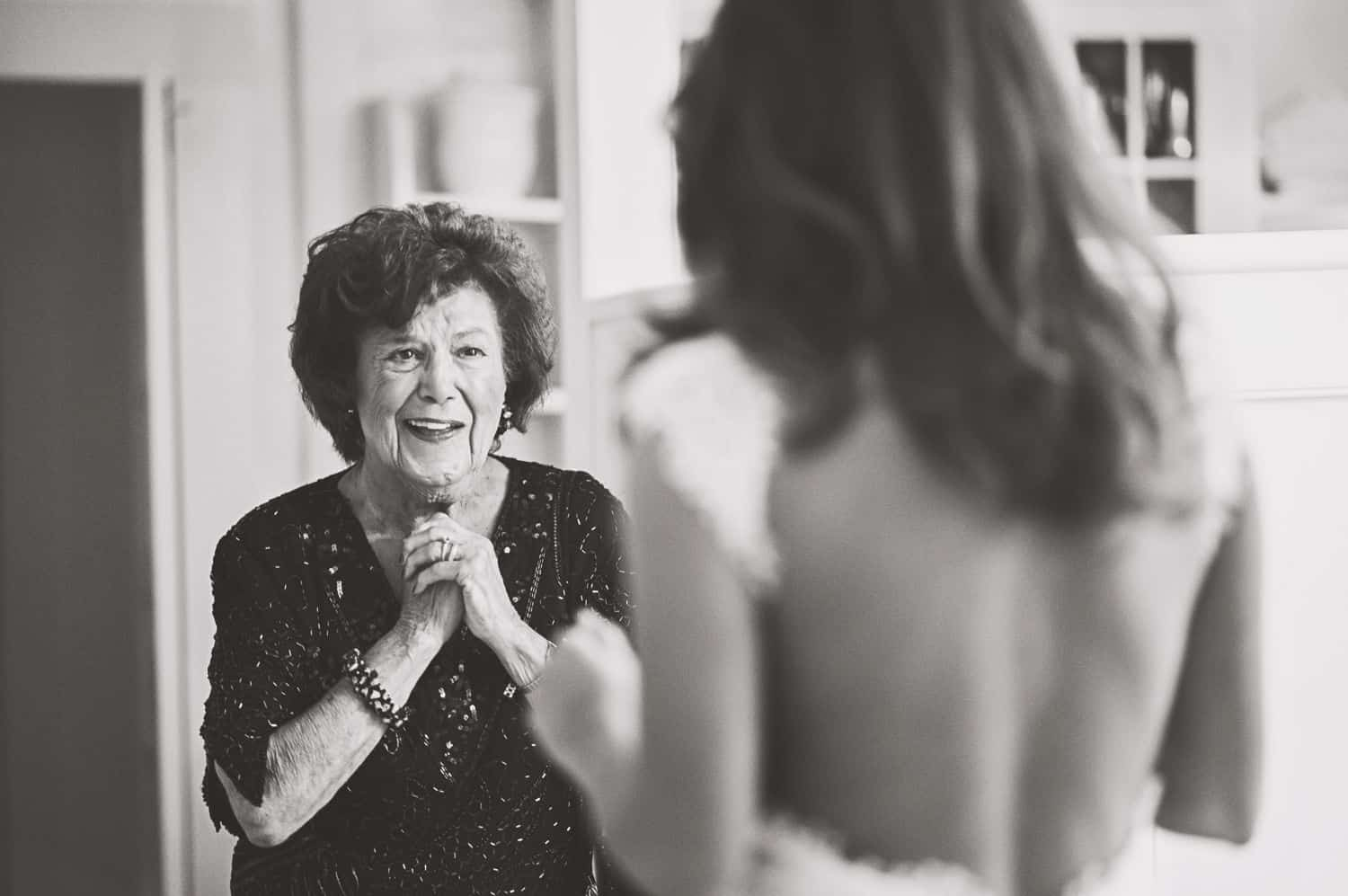 Mother sees daughter in wedding dress for the first time. By Harris & Co.