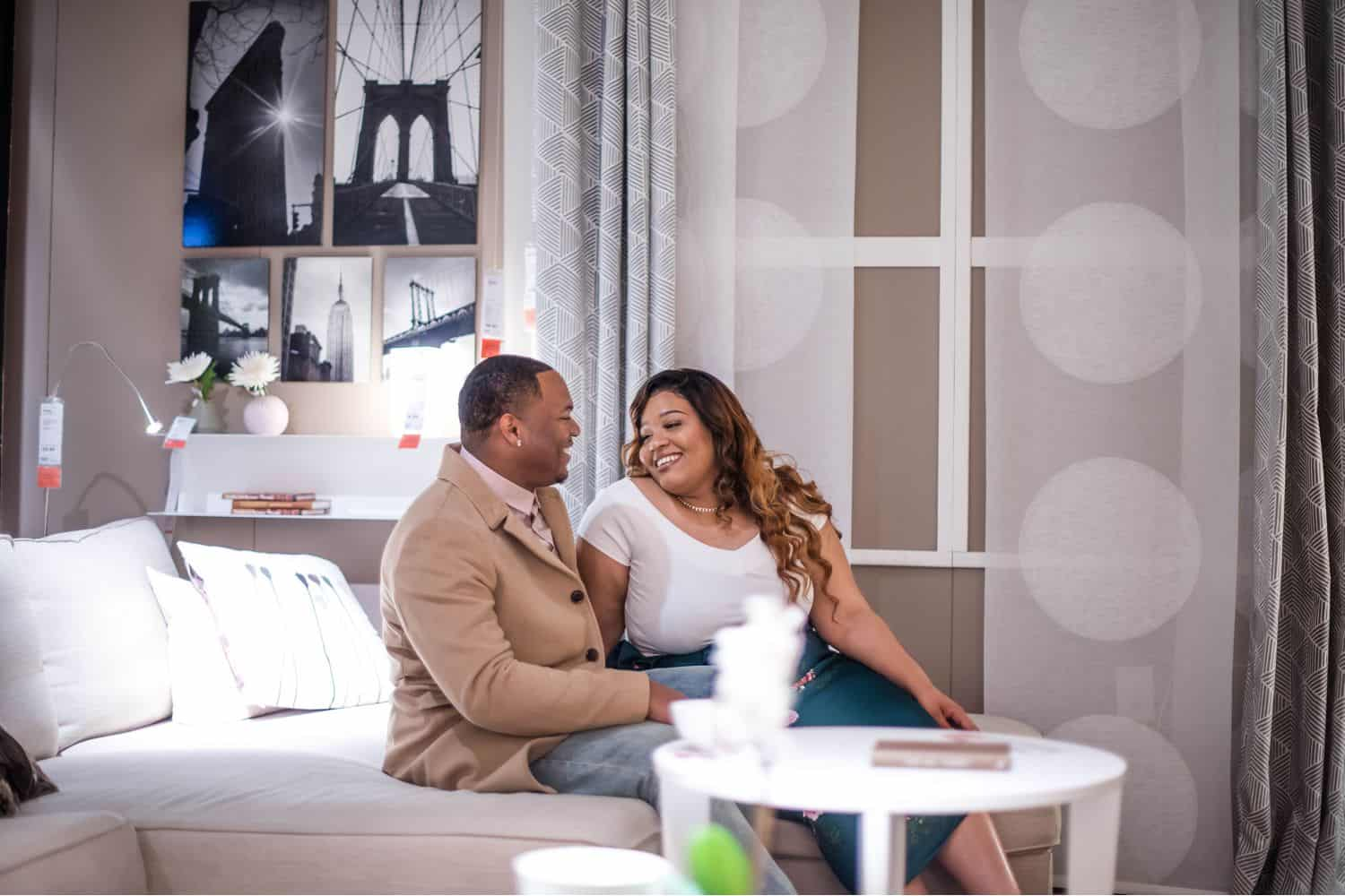 Great Engagement Images: Couple sitting together on IKEA bed.
