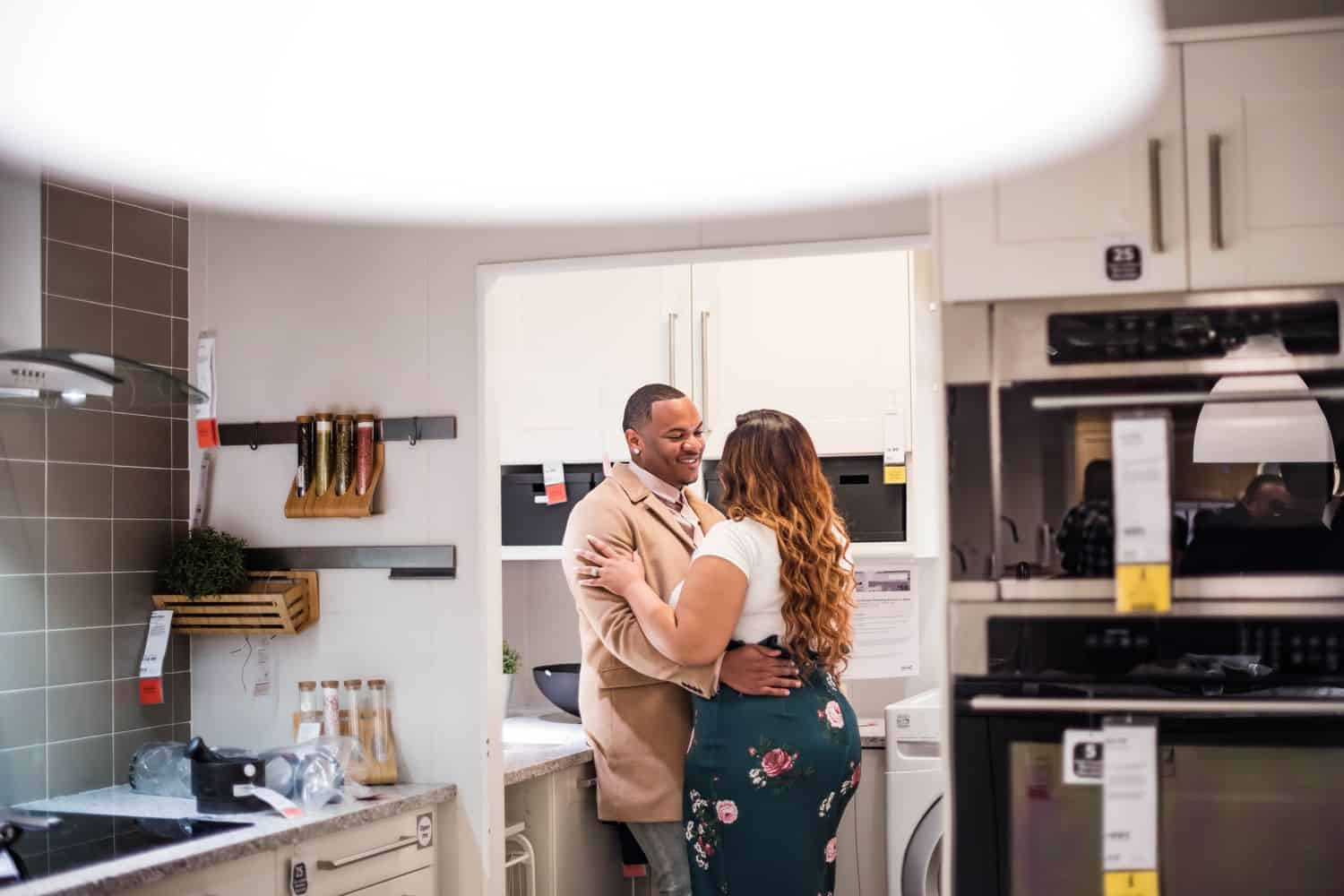 Great Engagement Sessions: Couple embraces in an IKEA kitchen.