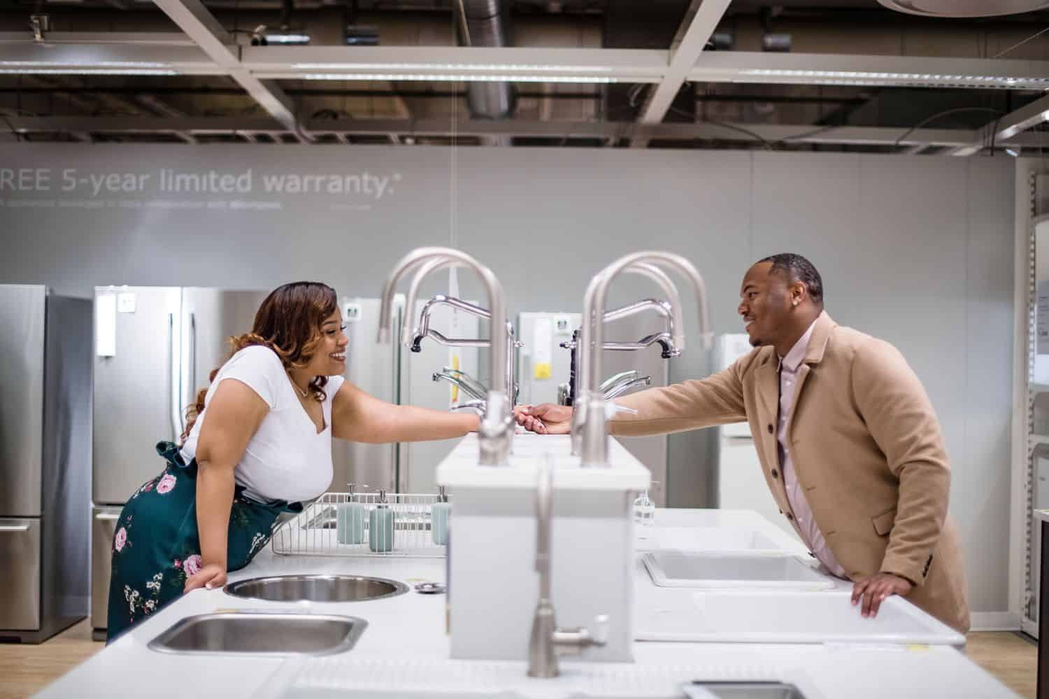 Great Engagement Photos: Couple holds hands in the IKEA sink department.