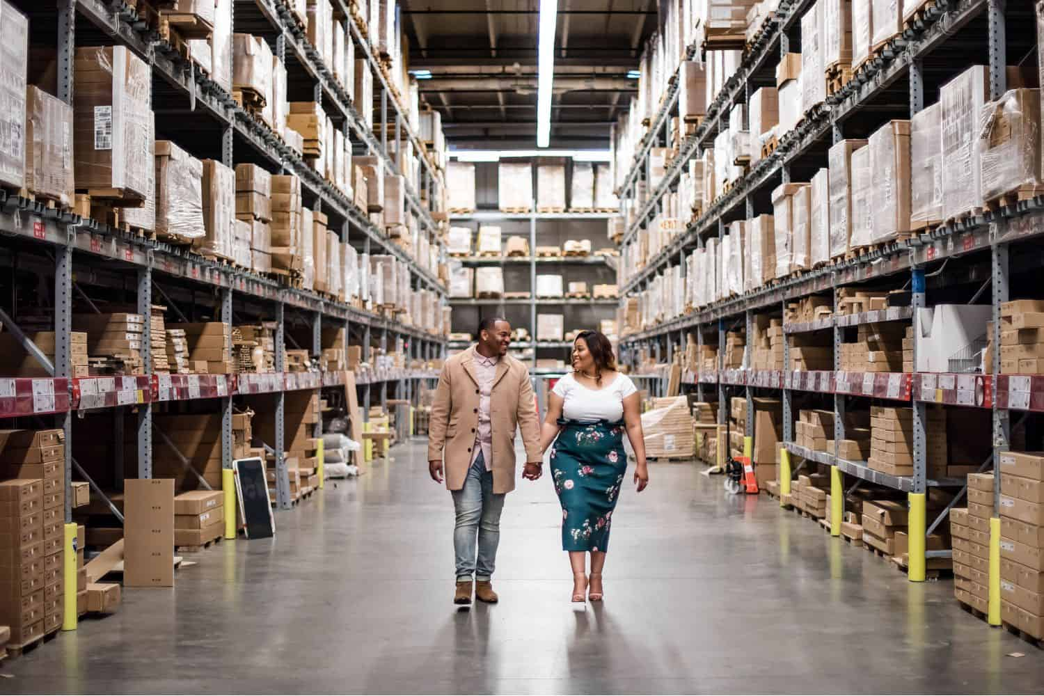 Great Engagement Sessions: Couple strolls hand-in-hand through the IKEA warehouse.