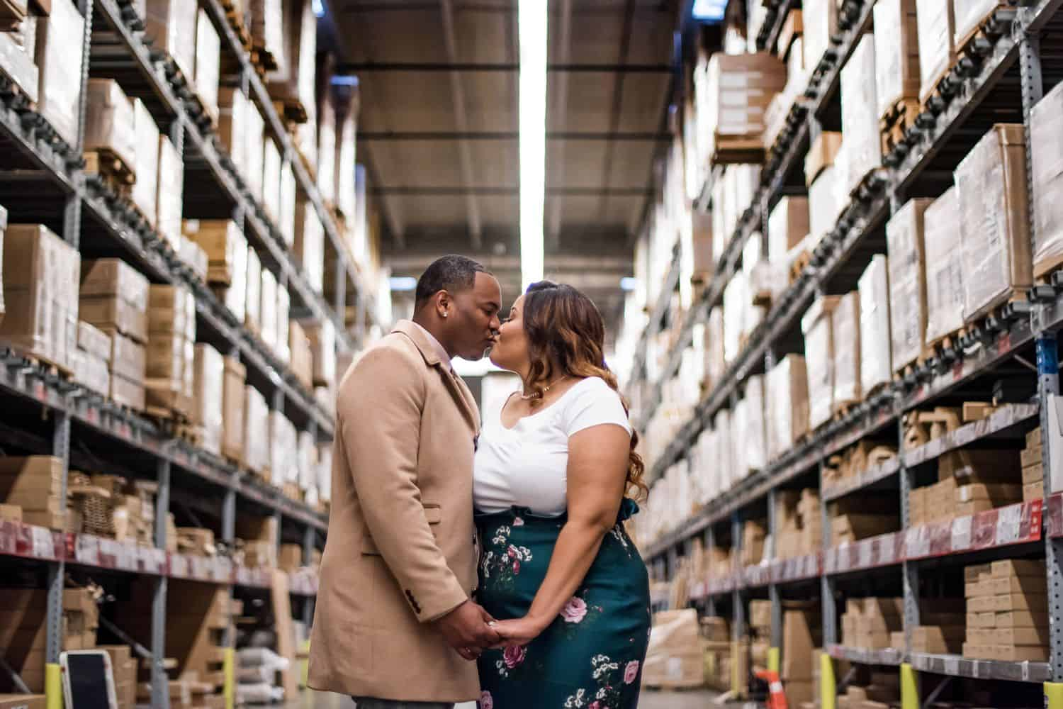 Great Engagement Images: Couple steals a kiss in the IKEA warehouse.