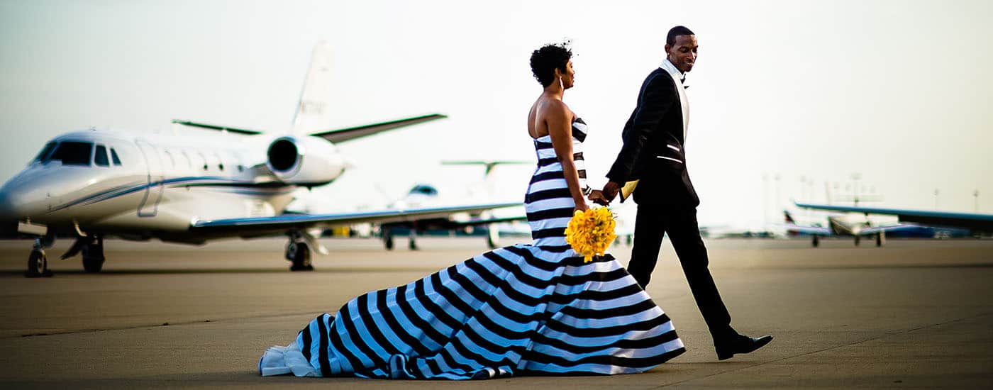 Is Táve Right for You? How To Market Smart & Track Your Cash: Couple in evening attire stroll accross runway at dusk.