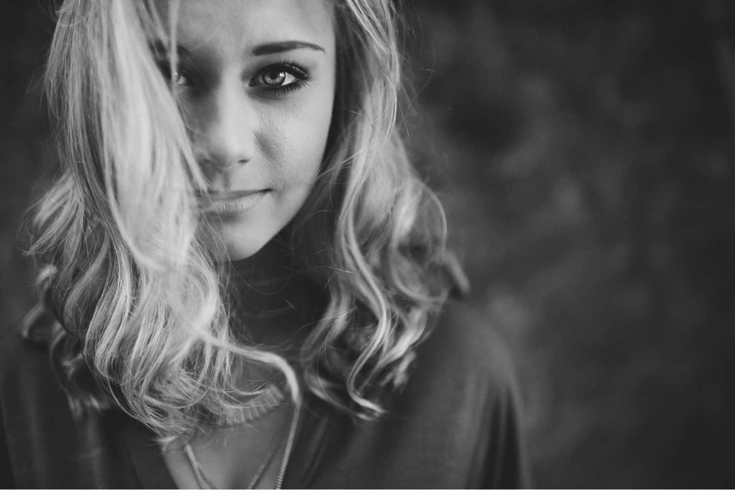 """I Quit Taking """"Safe"""" Photos. It Was the Best Decision of My Life. - Avoid photography burnout when you quit playing it safe. Beautiful blonde looking haunted in a black-and-white portrait."""