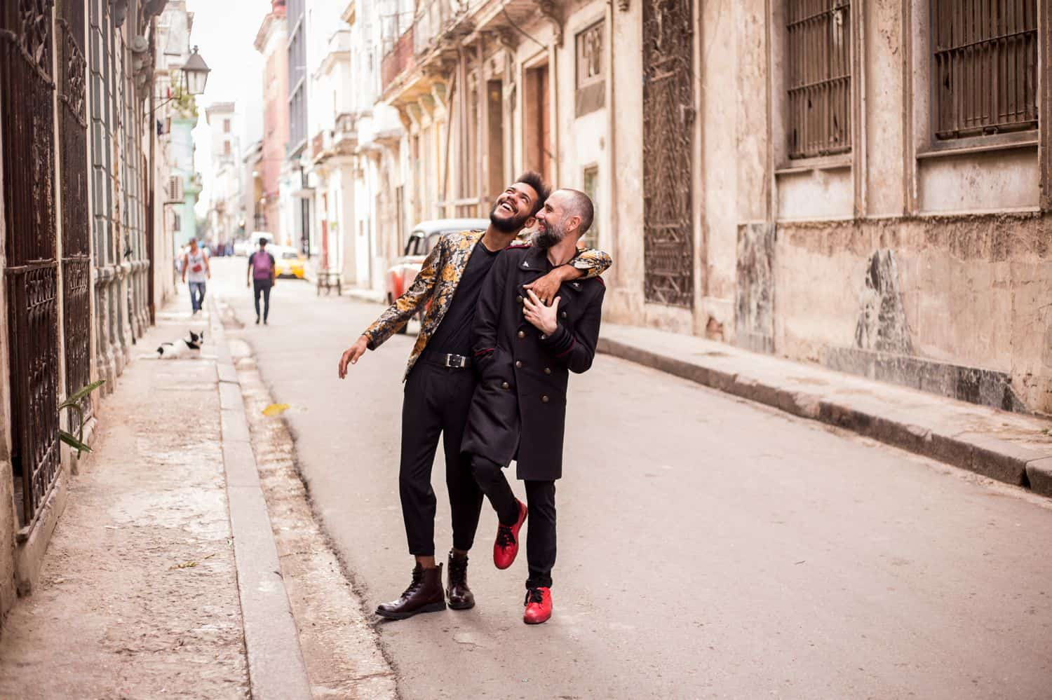 Skyrocket Your ShootProof Sales With One Easy App: Engaged couple walks through Havana streets laughing.
