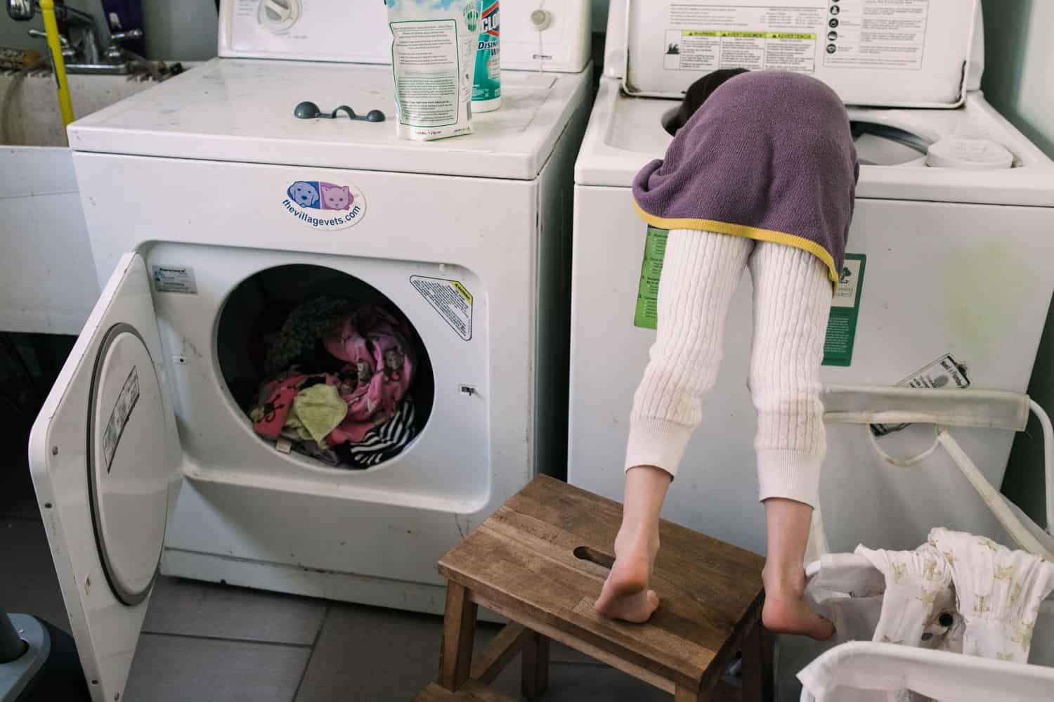 Fearless Family Photos All Have These 4 Ingredients: Lifestyle Photography - Little Girl Doing Laundry