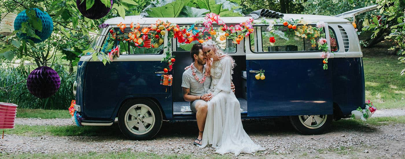 How To Find A Photography Website Template You'll Love: Wedding Couple In Their VW Van Bedecked In Flowers