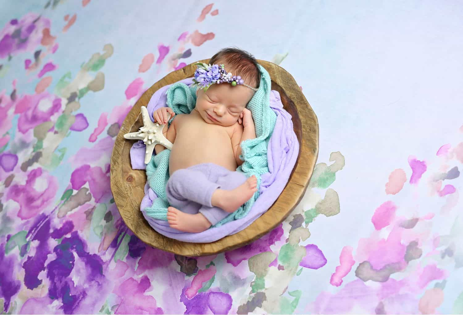 How To Attract New Clients In 3 Bold Business Moves: Baby on watercolor backdrop by Cassie Clayshulte