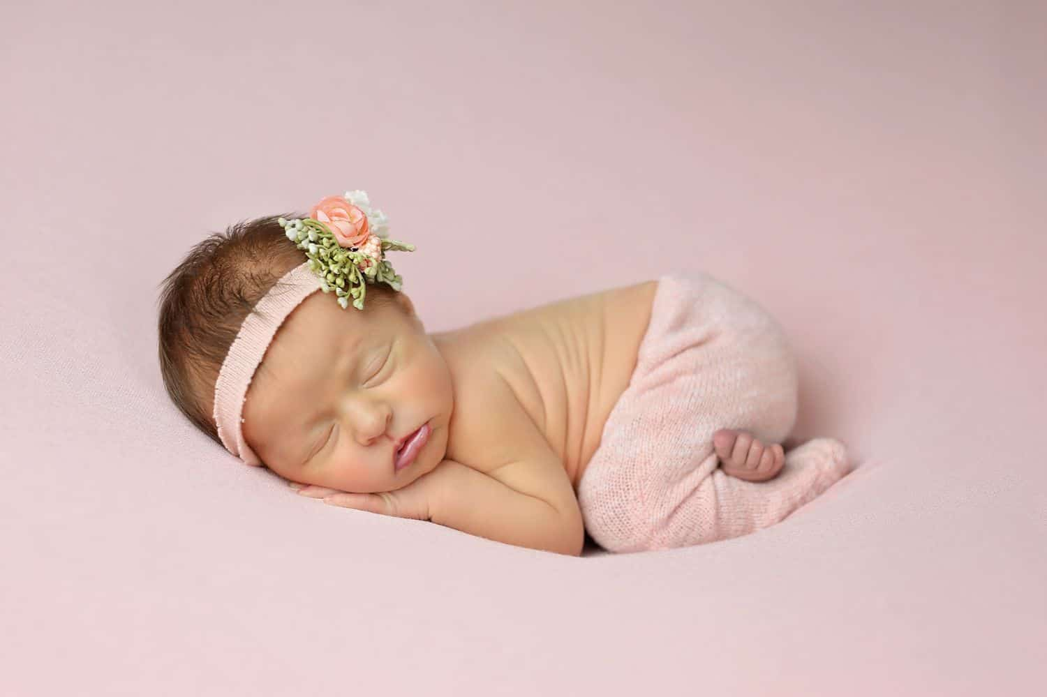 How To Attract New Clients In 3 Bold Business Moves: Newborn baby on pink blanket by Cassie Clayshulte