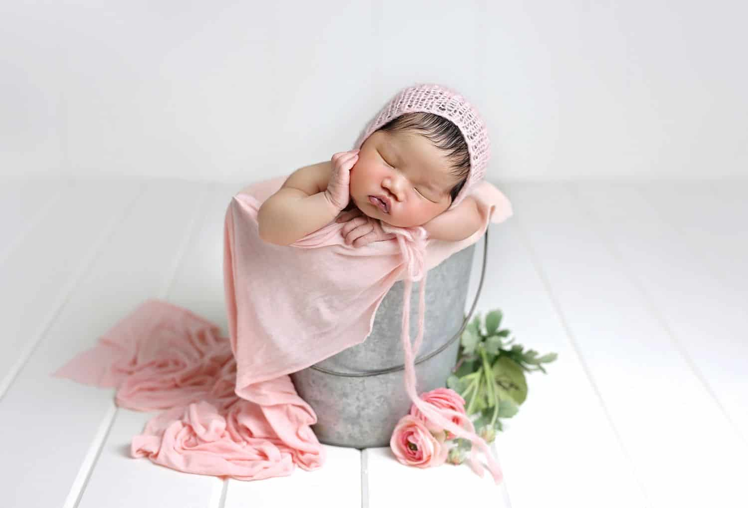 How To Attract New Clients In 3 Bold Business Moves: Baby in a bucket by Cassie Clayshulte