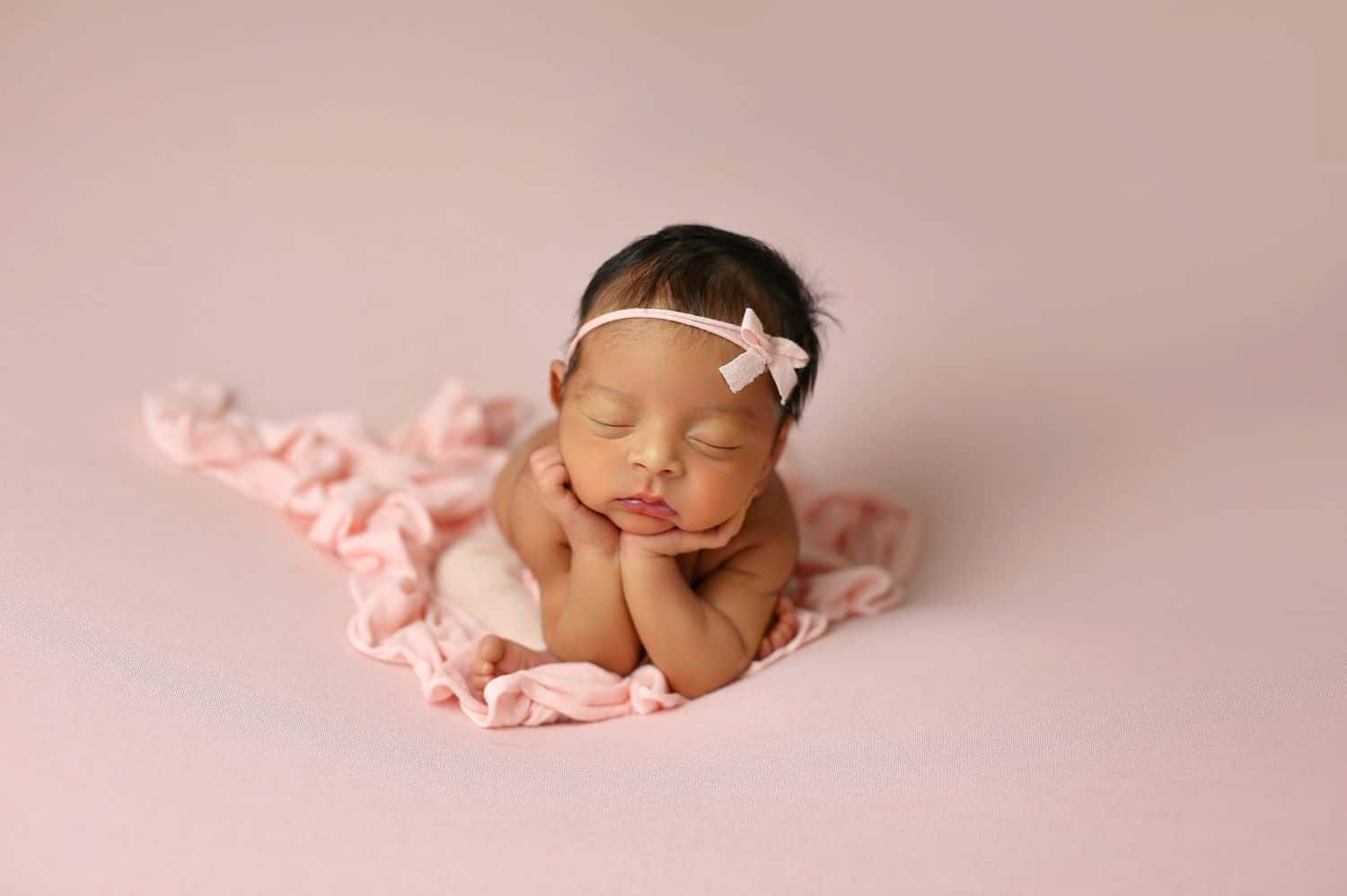 How To Attract New Clients In 3 Bold Business Moves: Newborn baby girl on pink backdrop by Cassie Clayshulte