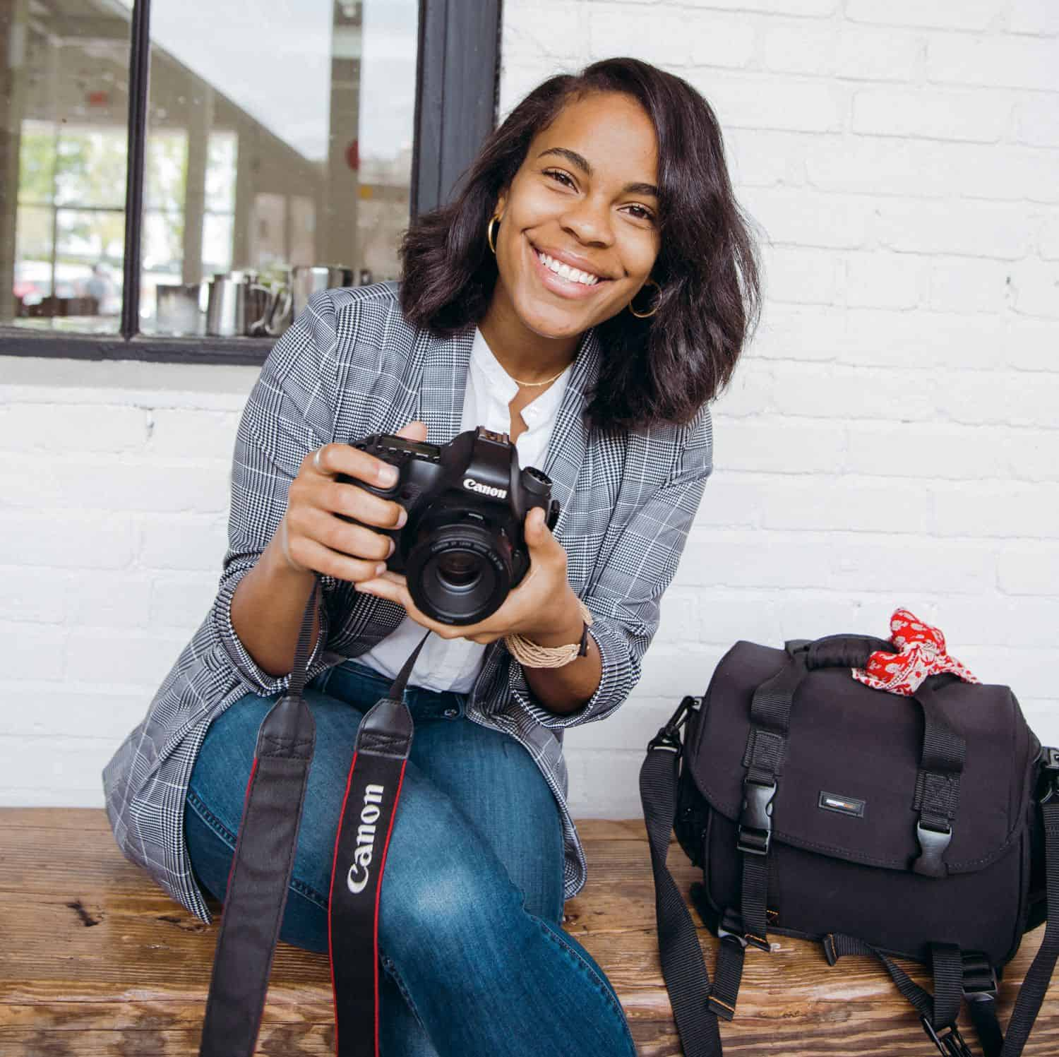 #ShootProofPro: 7 Stories for Days When You Think You Suck (Portrait of photographer Tina J. Smith holding her camera.)