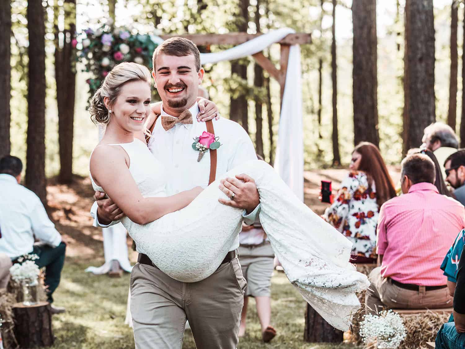 "groom carries bride up the aisle after they say ""i do"""