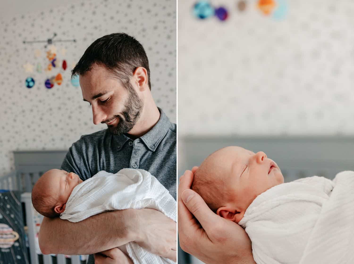 Dad holds his newborn son in the nursery.