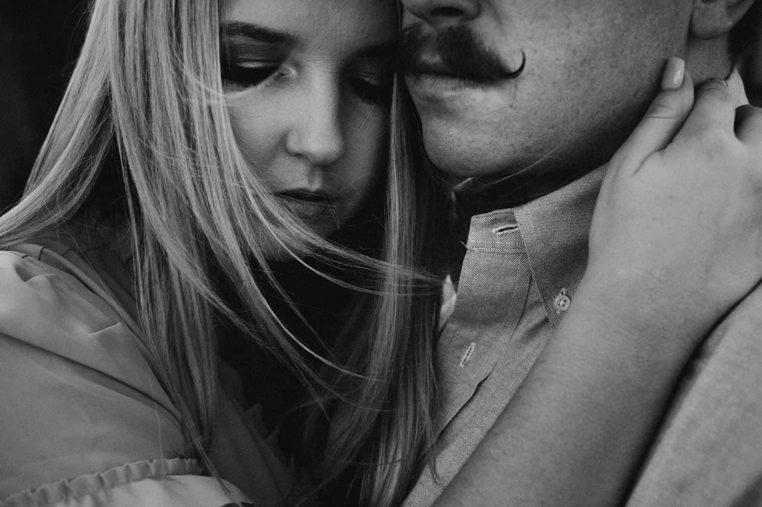 black and white photos of a couple embracing close-up