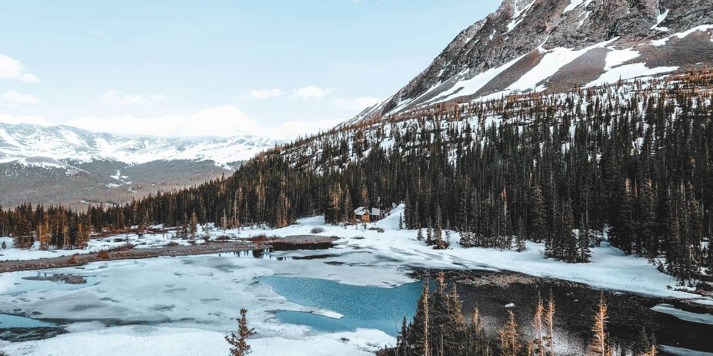 Landscape photograph of a frozen mountain lake.