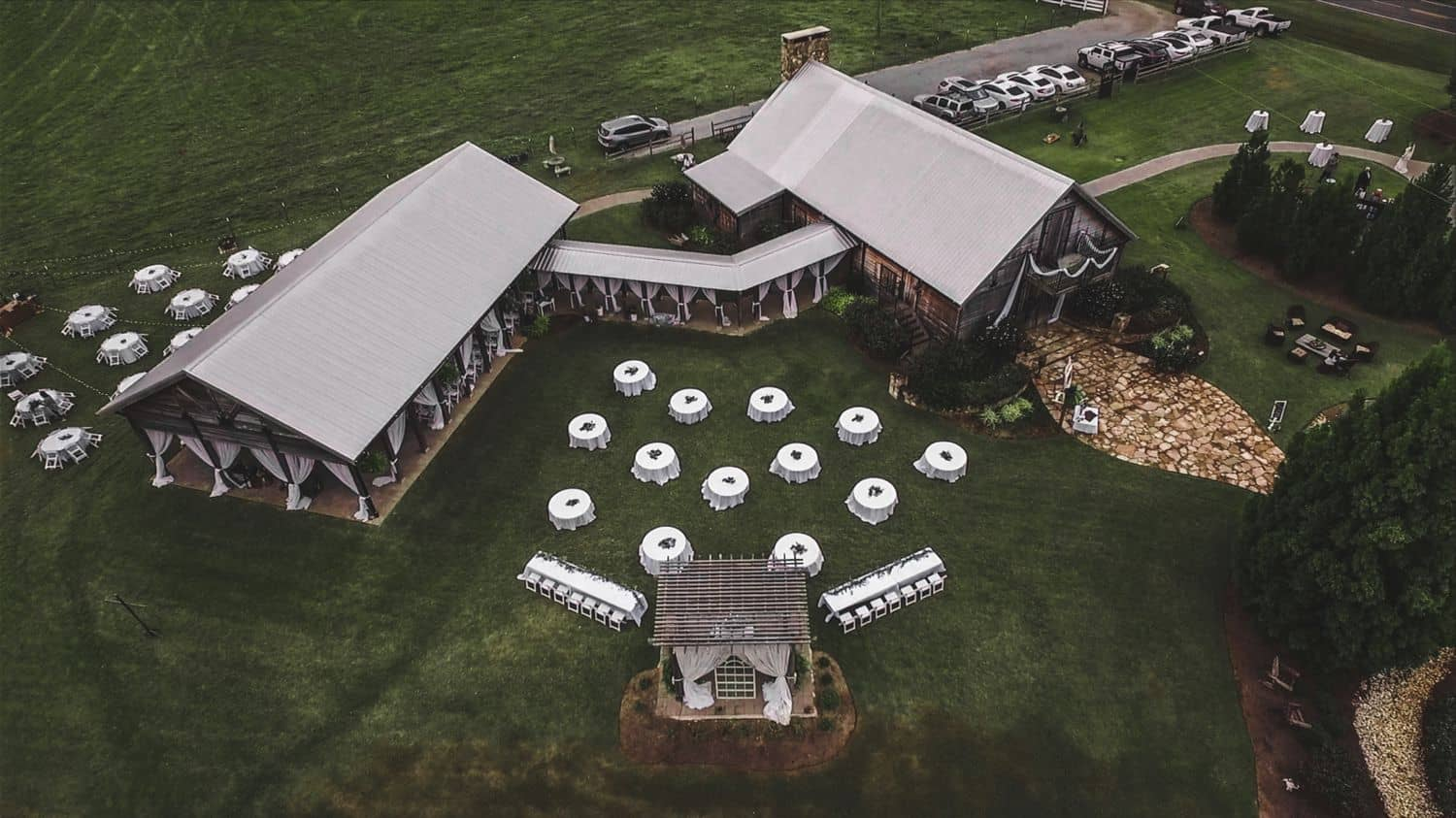 Drone shot of a farm wedding venue shot from above.