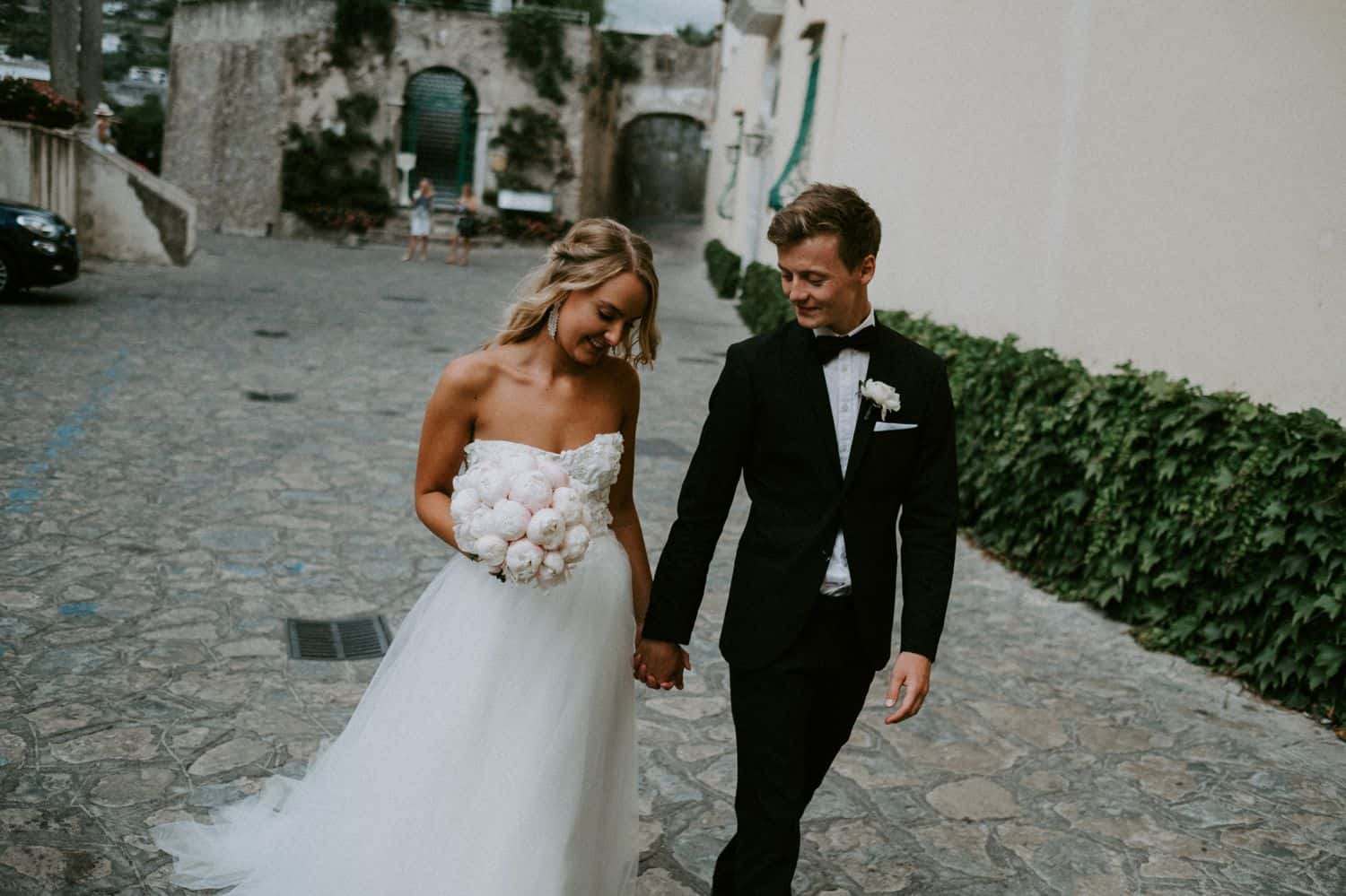Van Middleton: Newlyweds stroll down cobblestone alley.