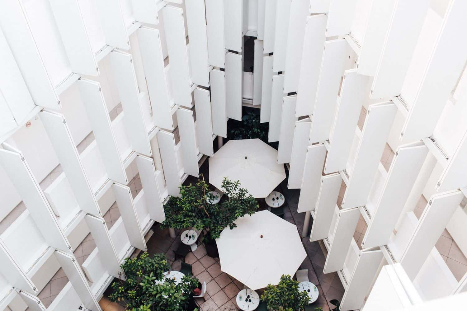 birds-eye view of a whitewashed atrium