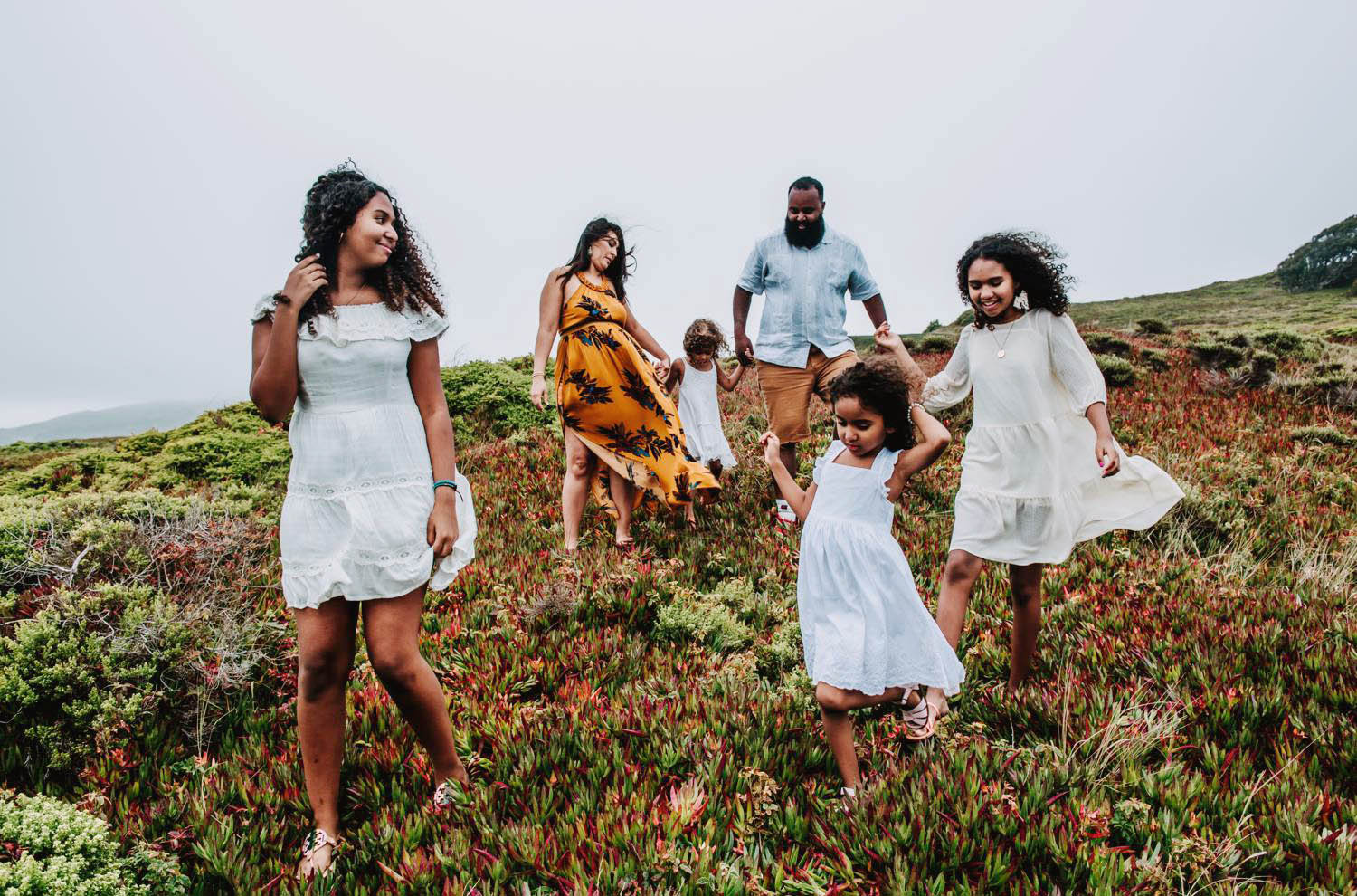 Captured Happiness Photography photographs a family in Hawaii as they anticipate the birth of their 5th child