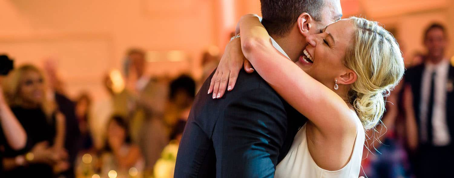 Make Money with Photography: bride and groom dance with bride's arms around groom's shoulders