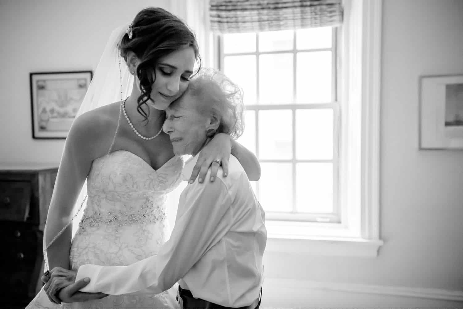 Make Money with Photography: bride hugs her much smaller grandmother