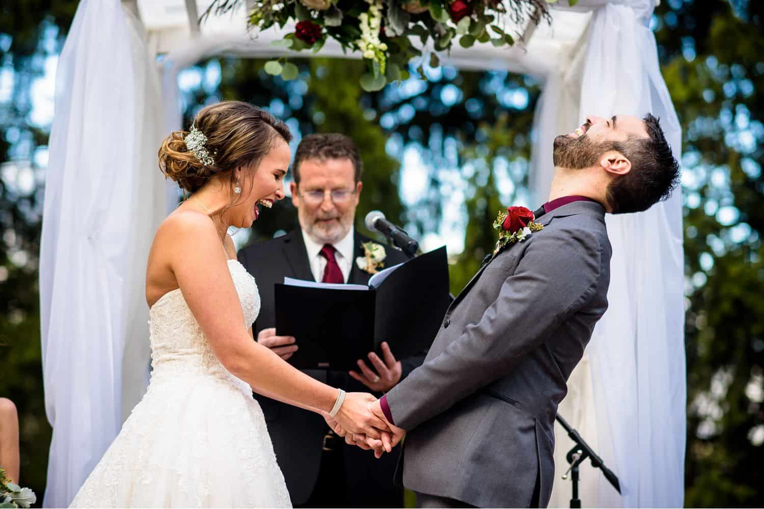Make Money with Photography: Bride laughs and groom throws back his head while they hold hands mid-ceremony
