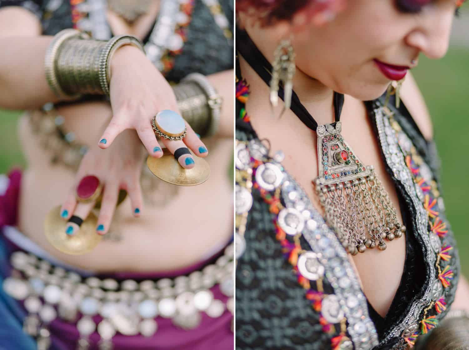 a belly dancer's hands and jewelry are depicted in close-up detail