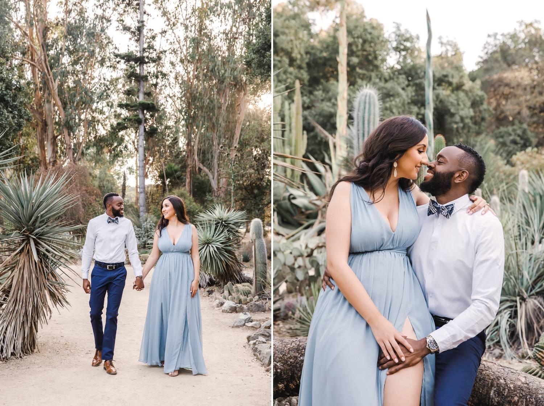 A man and woman stroll through a garden of succulents