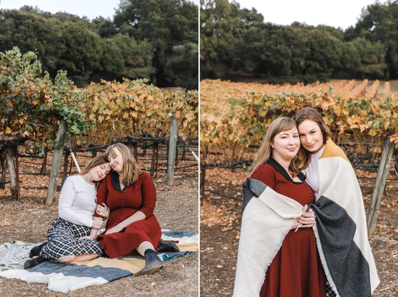 Two women enjoy a picnic at a vineyard
