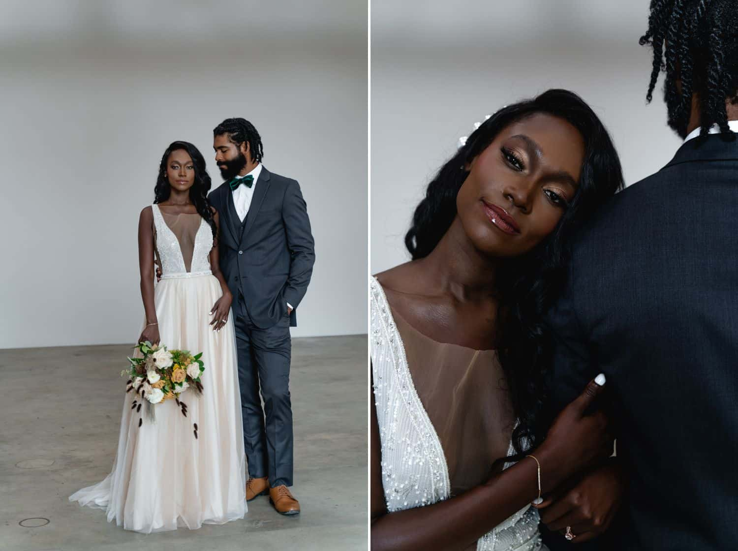 A Black bride and groom stand in a dimly lit studio in front of a white backdrop.