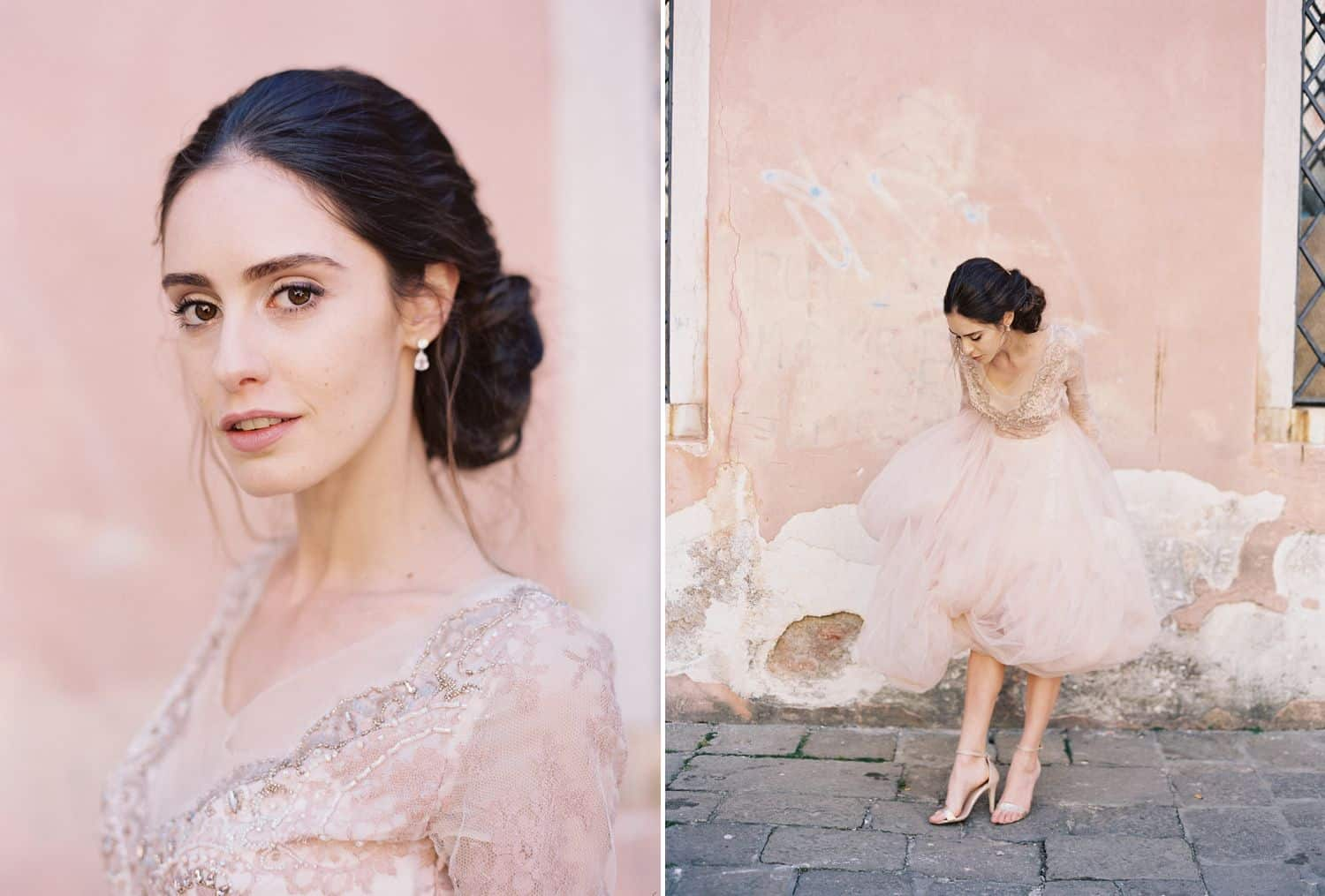 A brunette bride wears a pink wedding gown and her hair in a chignon. She poses before a pink wall.
