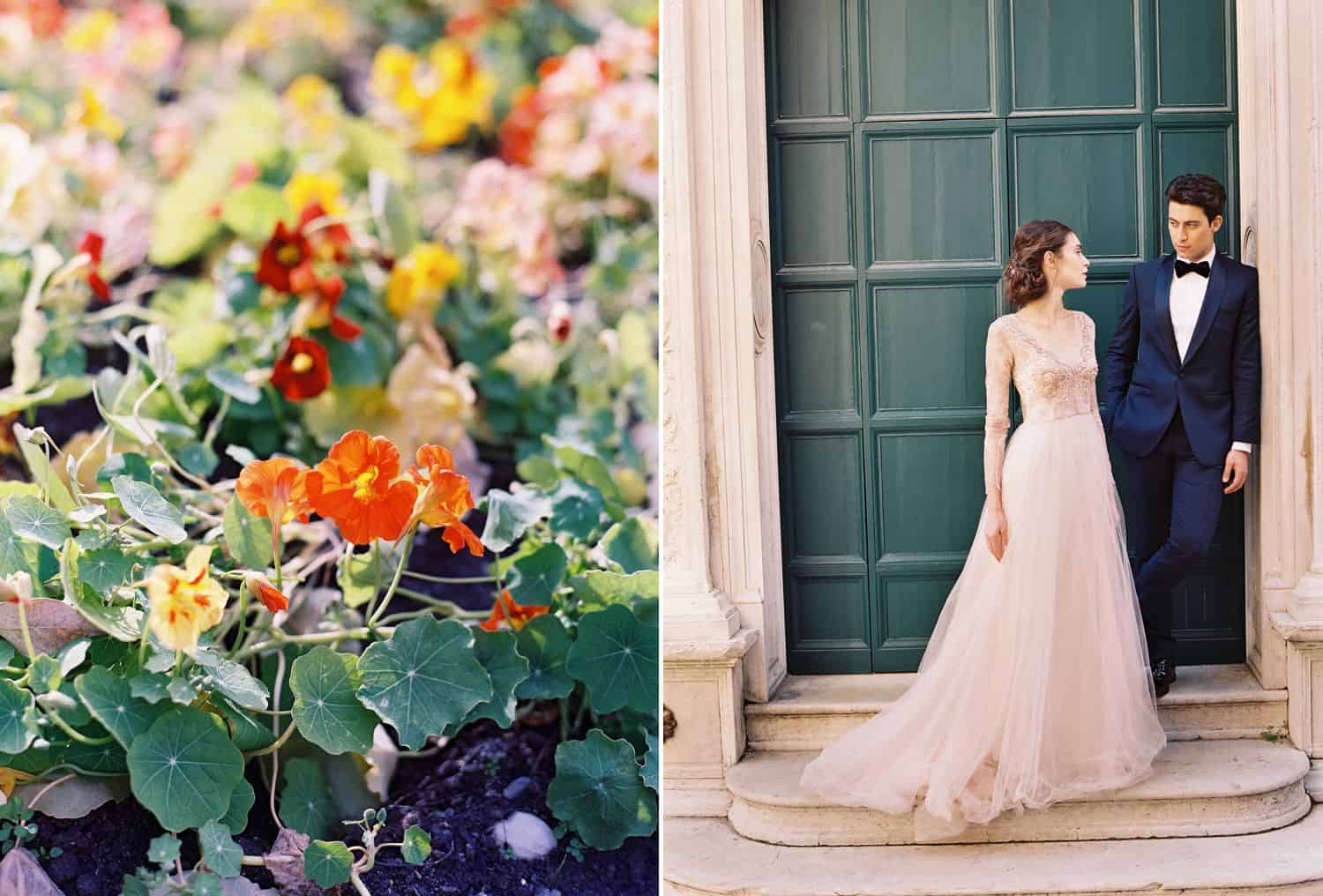 A field of colorful flowers is pictures beside a bride in a pink dress who stands in front of a green door with her groom.