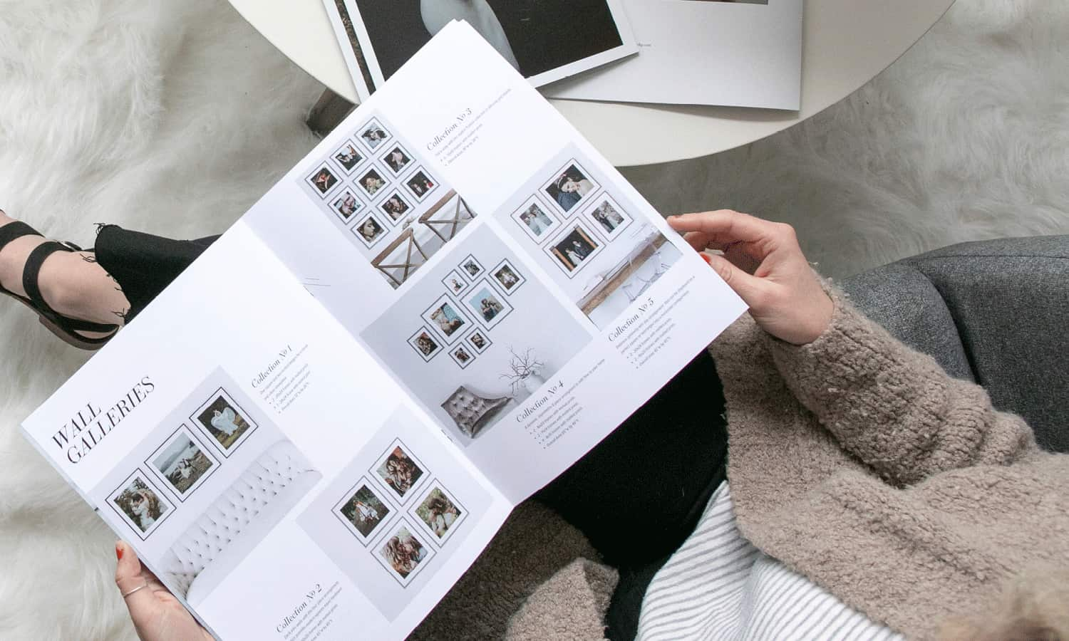 A Photography Lookbook by Design Aglow is shown here open on a client's lap.