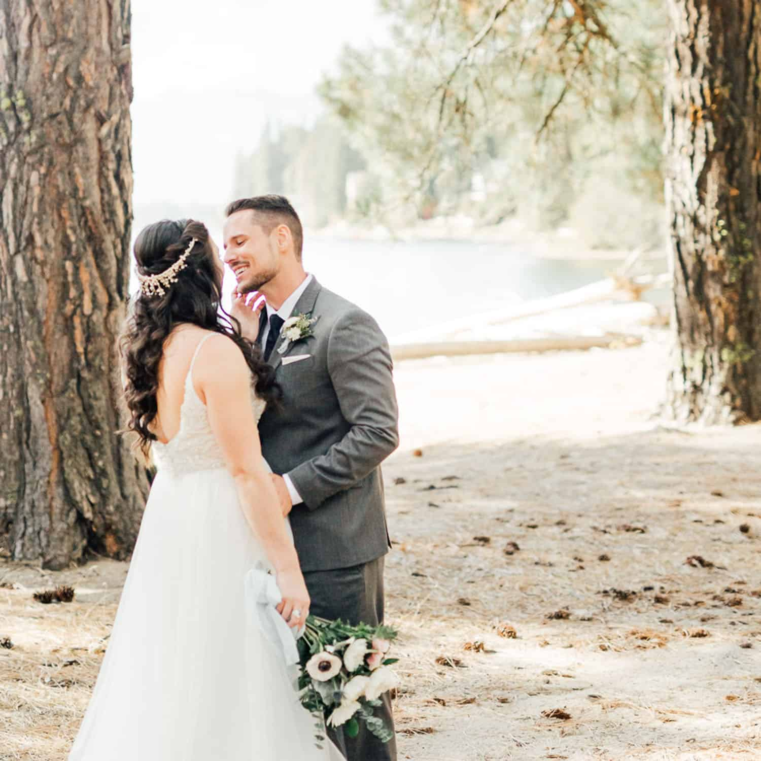 Shelby Schmidt's portrait of a bride and groom gazing into one another's eyes in a lakeside forest