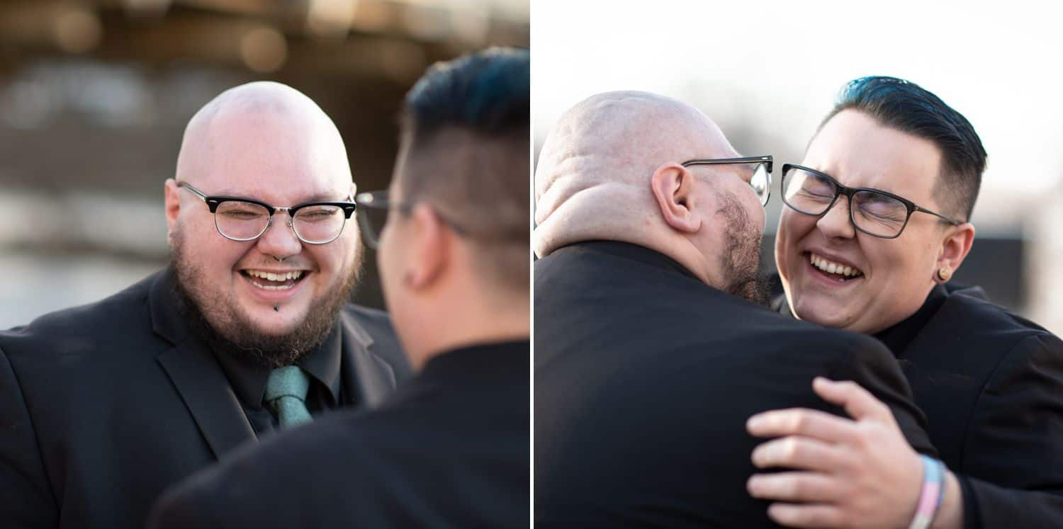 Two just-married husbands laugh and smile