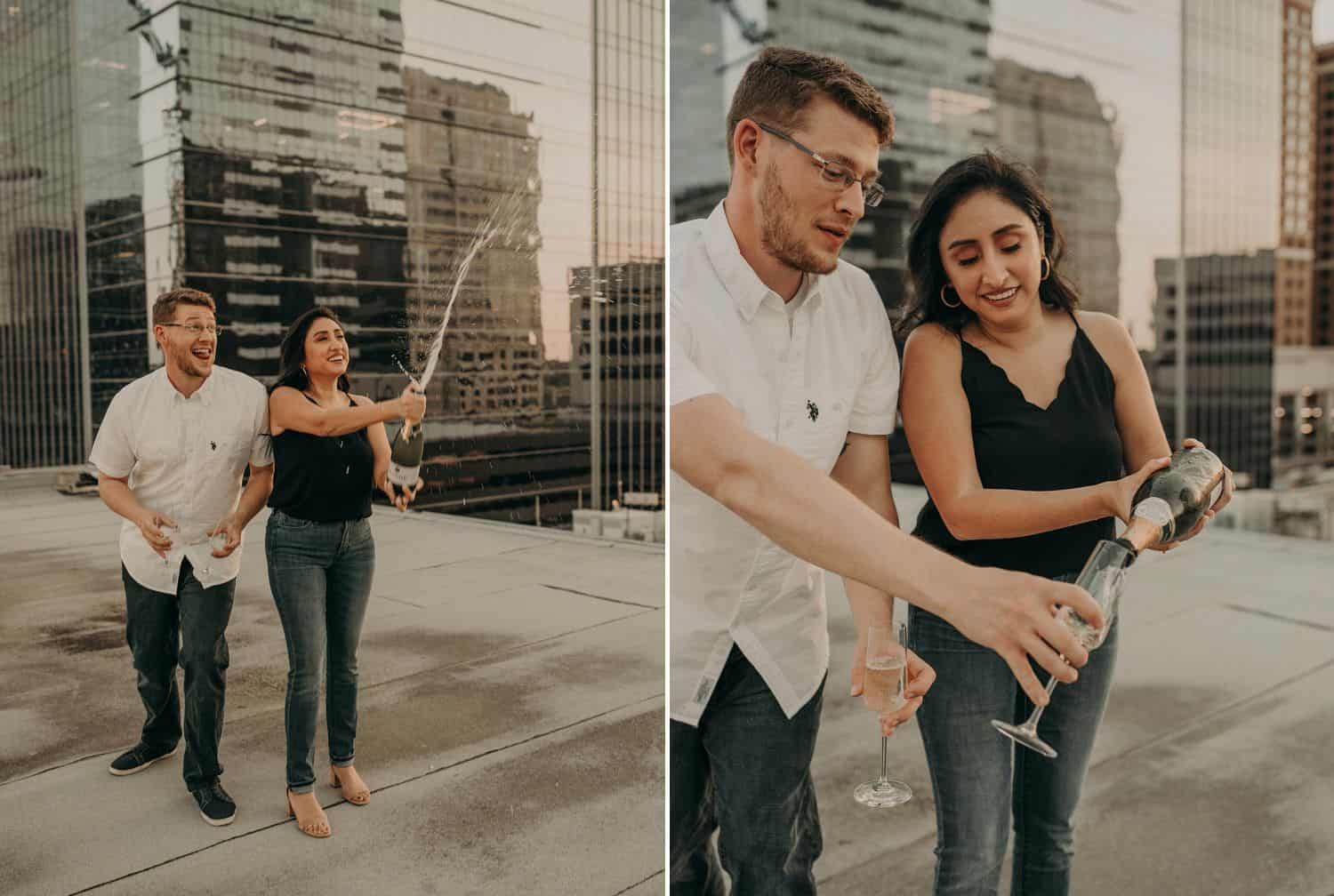 A couple pops a bottle of champagne and celebrates with drinks on a city rooftop