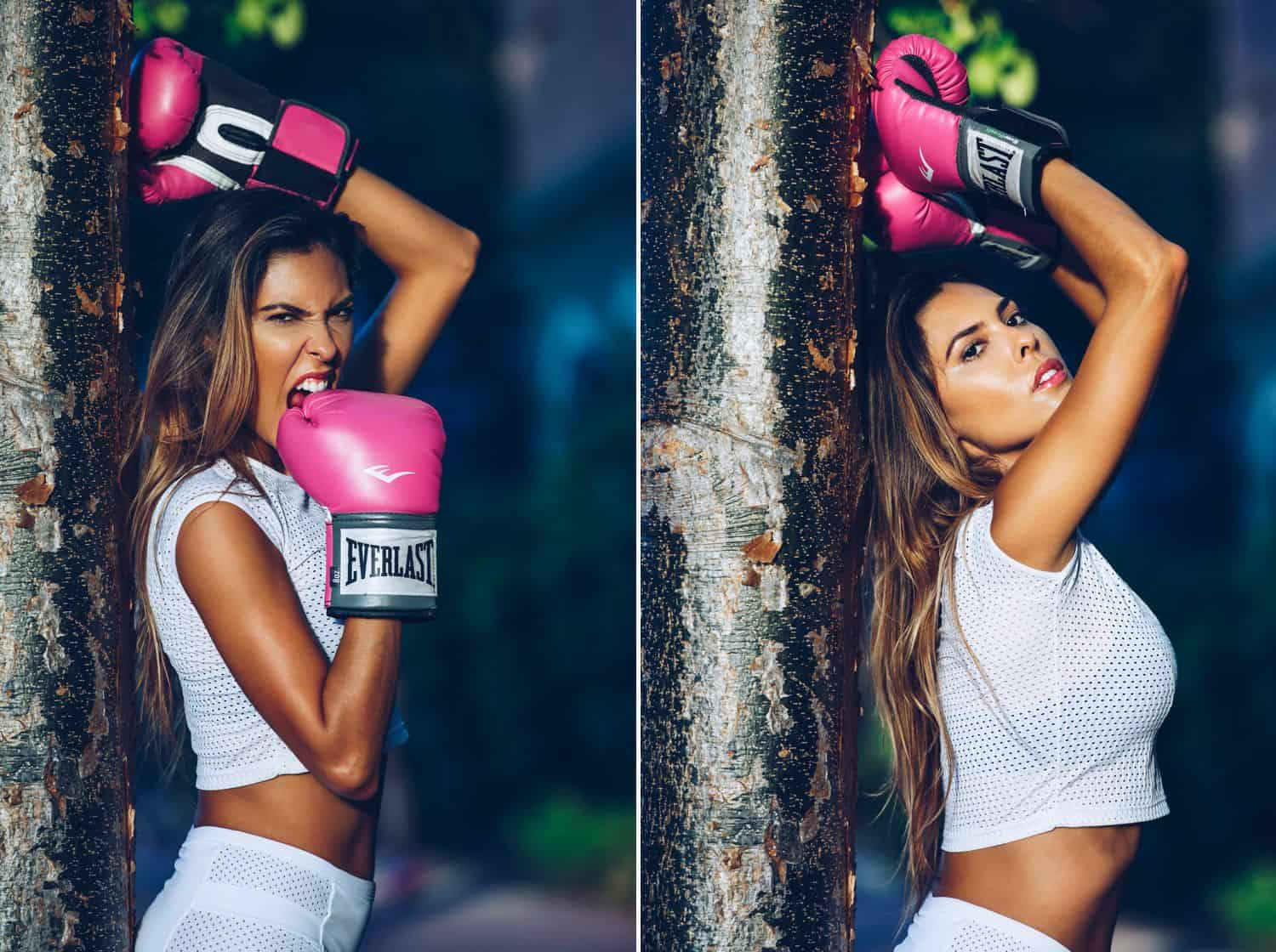 A Brazilian model wearing white workout attire poses with bright pink boxing gloves
